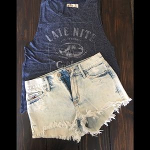 Distressed denim shorts with embellished pockets!